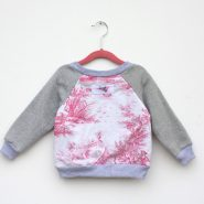 pink and white baby jumper back